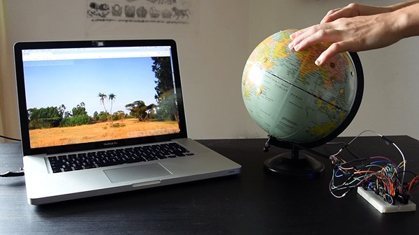 Haal vakantieherinneringen op met deze interactieve globe