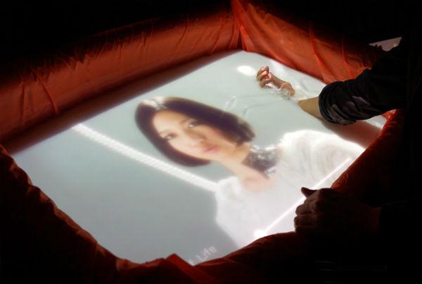 AquaTop: een touchscreen van water