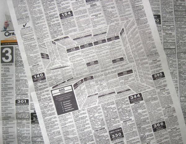 Deze reclame verbergt een driedimensionale keuken in de krant