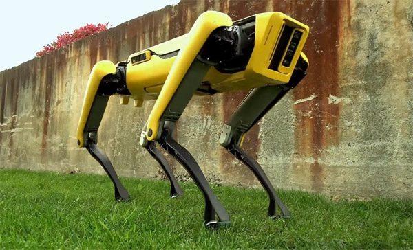 Zie hoe een groep SpotMini-robots een vrachtwagen voorttrekt